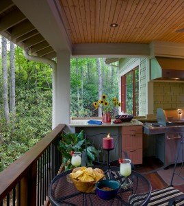 Outdoor kitchen and covered porch designed by ACM Design