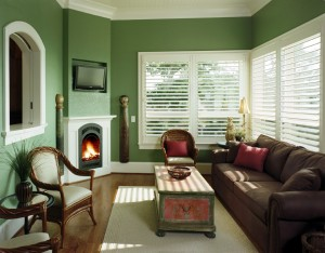 Sunroom with fireplace designed by ACM Design