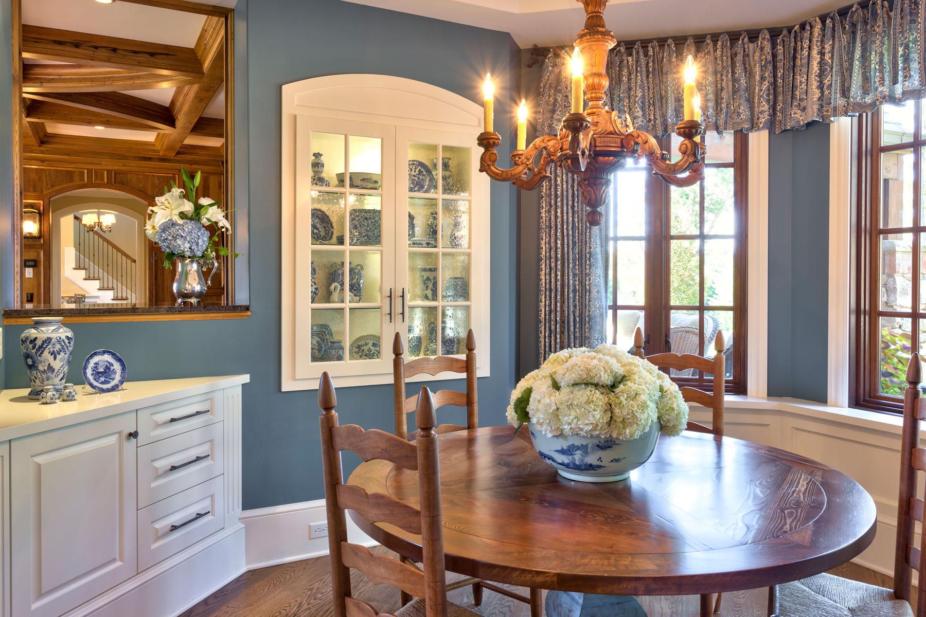 bright-breakfast-room-blue-pottery