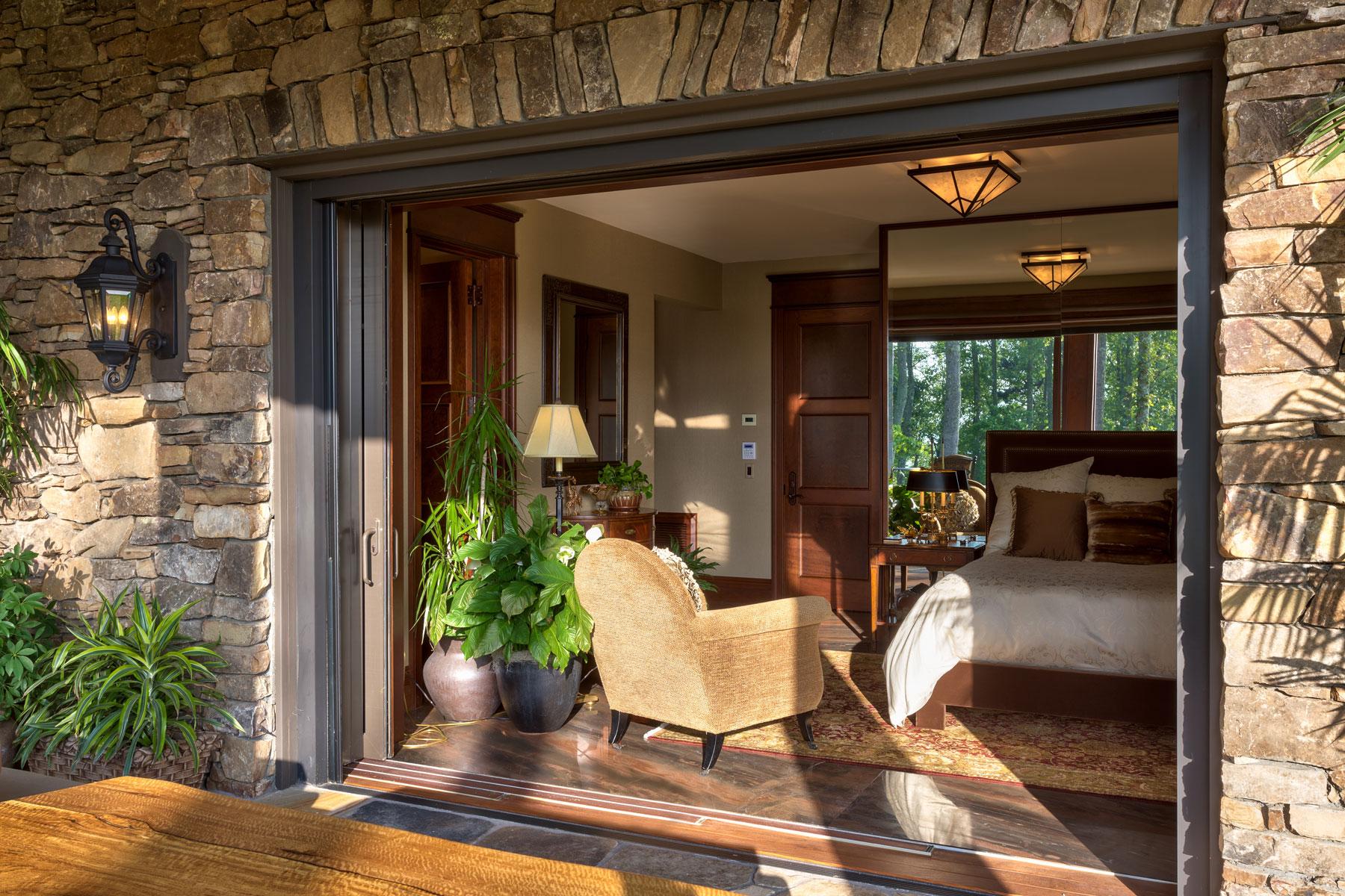 Guest bedroom with vanishing pick doors to outdoor patio