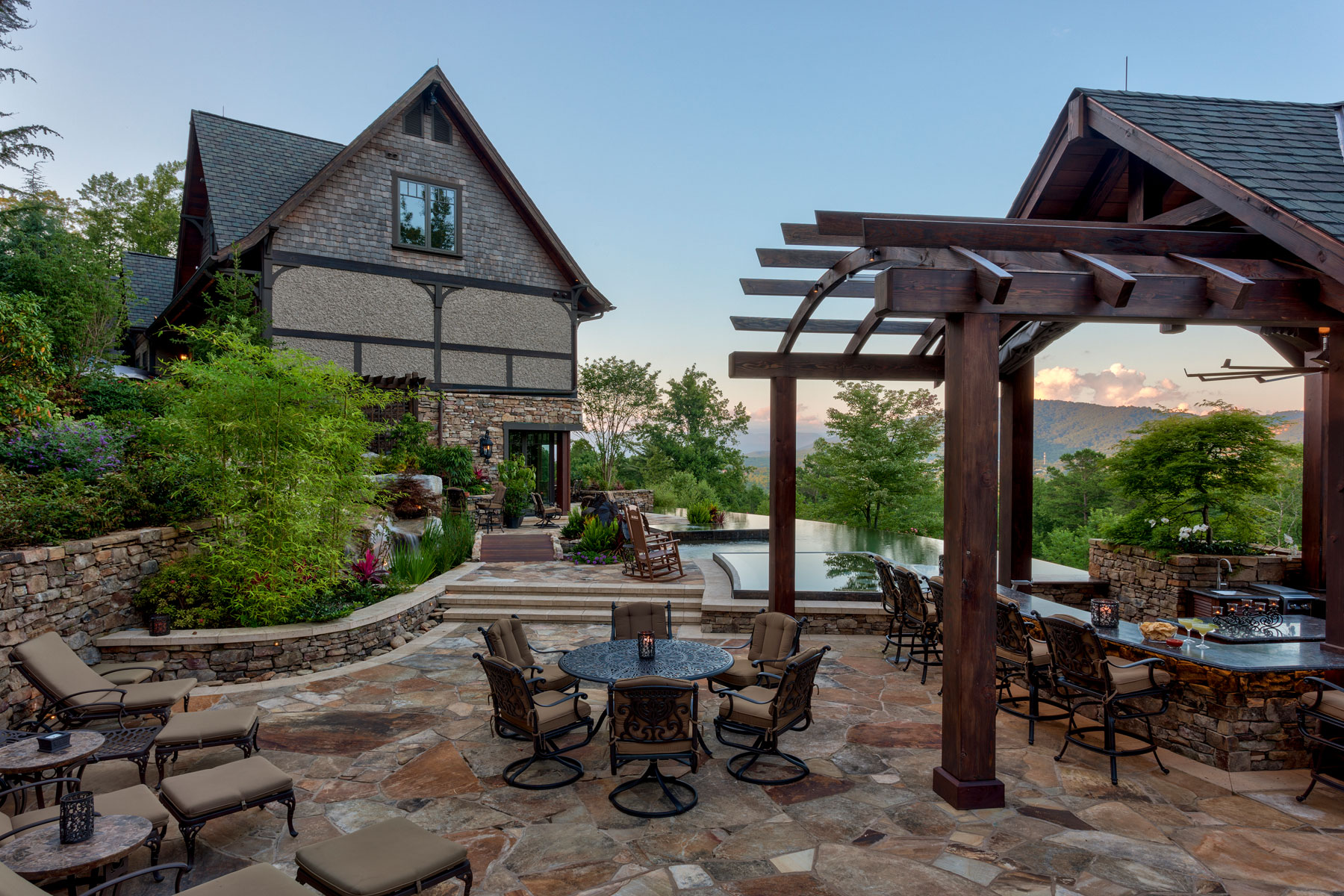Outdoor Entertaining with a view of Downtown Asheville. Stone patio, outdoor kitchen, bar, infinity edge, mountain-side pool