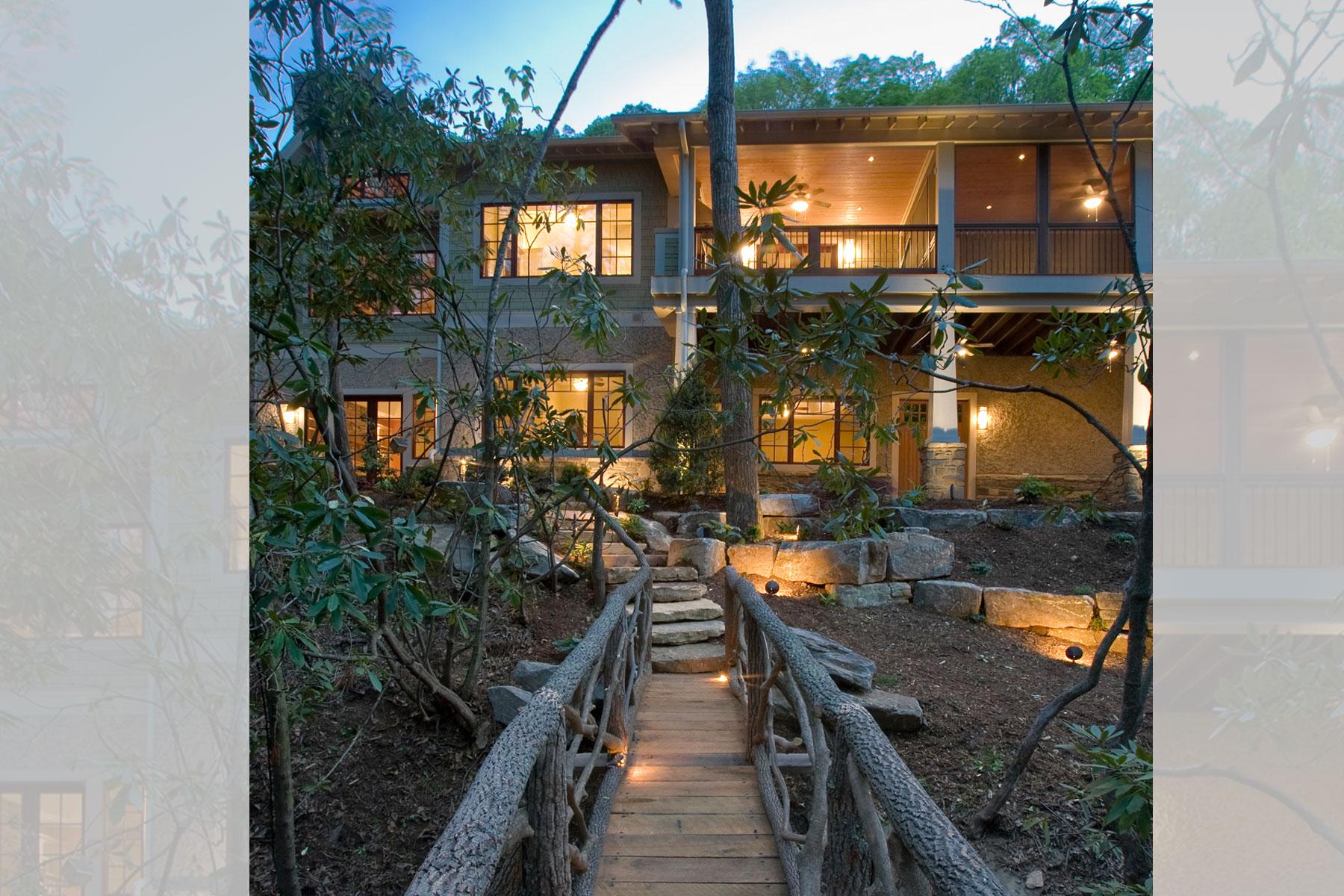 Bridge in backyard of mountain craftsman home