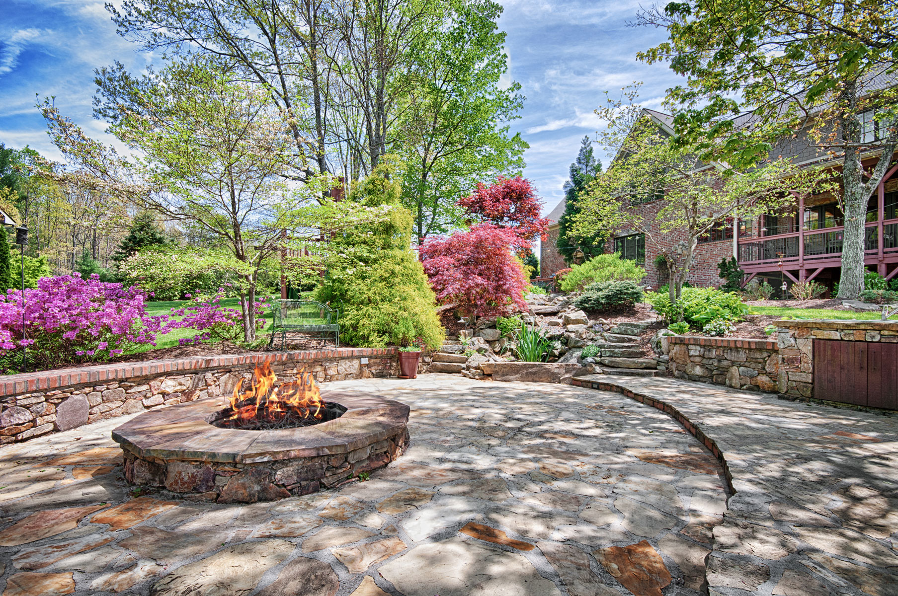 Rear yard with stone patio and firepit