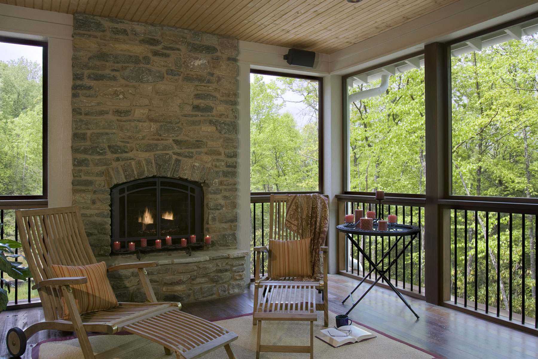 Screened porch with wood burning fireplace in stacked stone