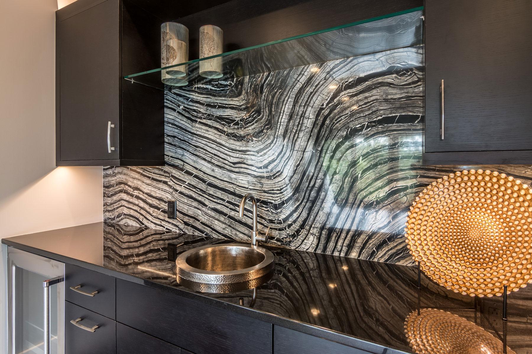 Bar with exotic granite backsplash, modern design