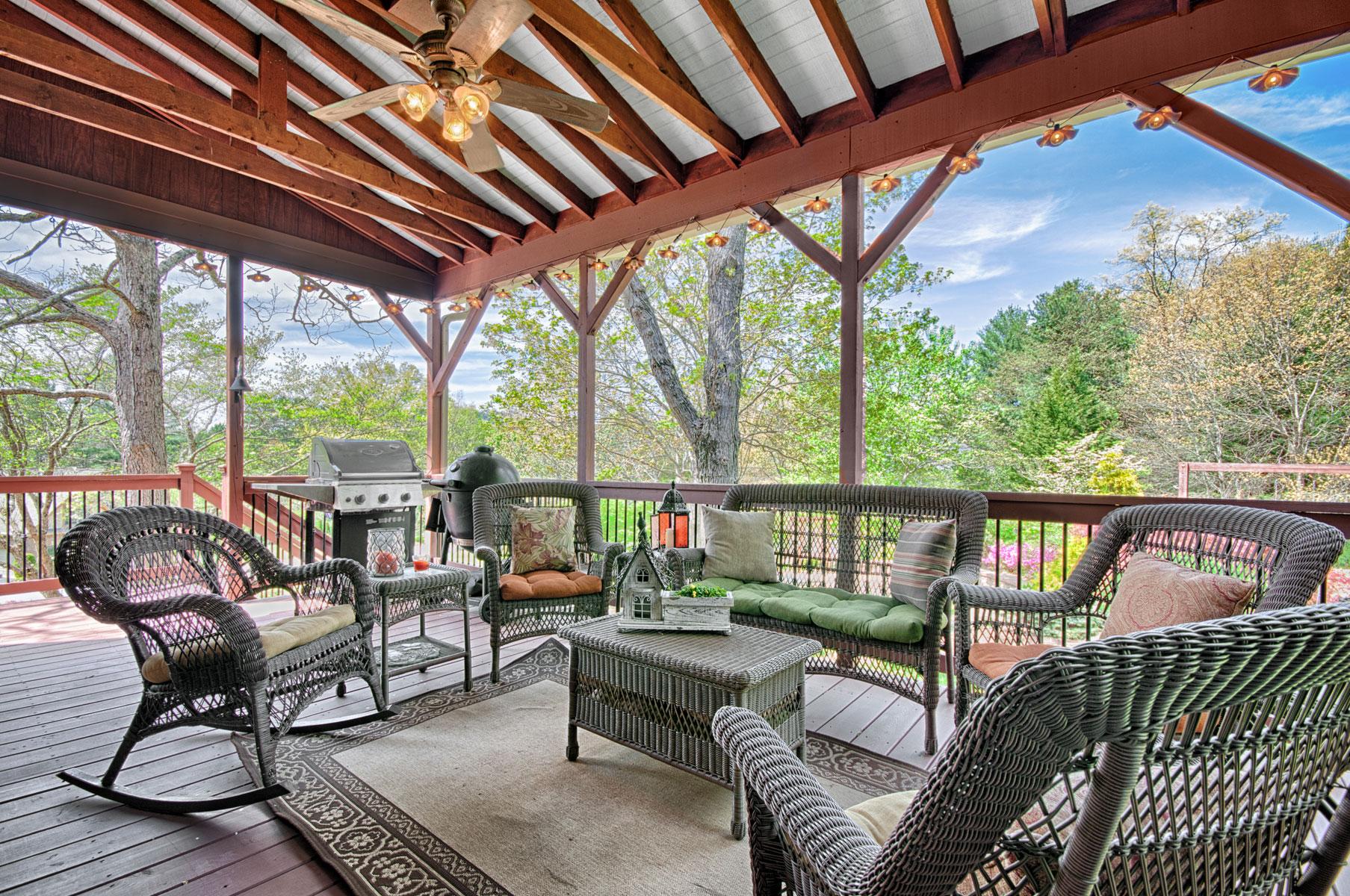 Covered deck overlooking backyard