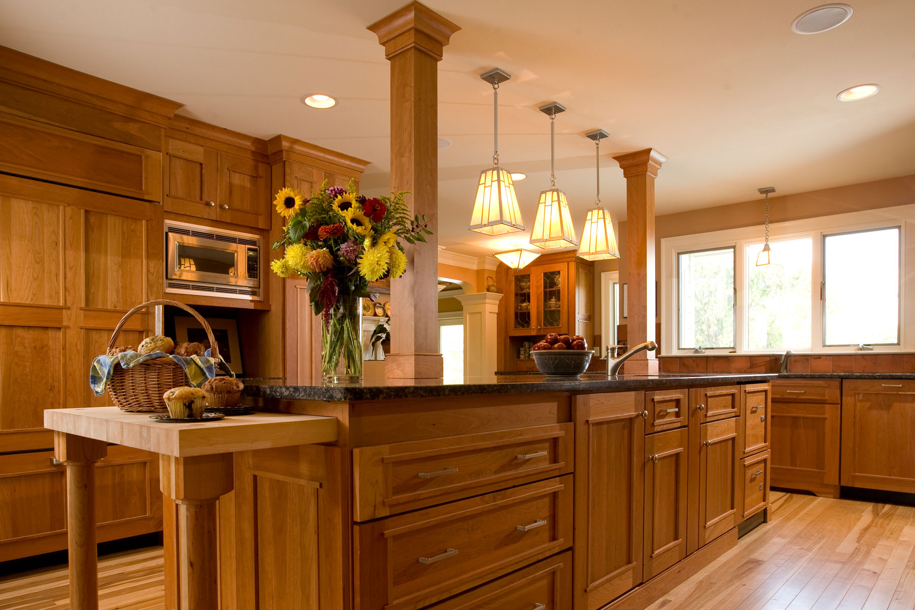 Craftsman style kitchen with rich wood cabinets