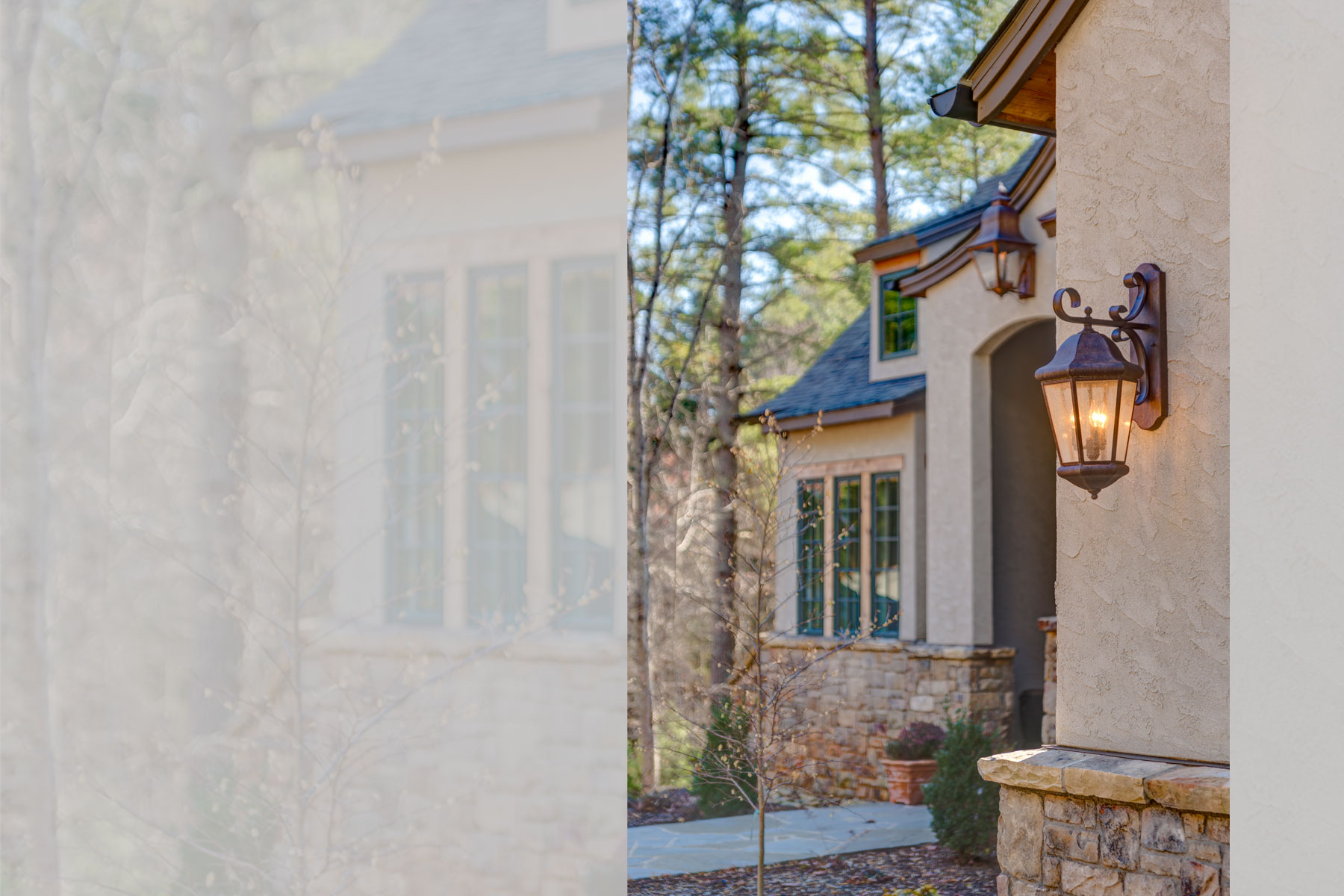 Exterior detail: light fixtures and stone work on stucco european romantic style home in Biltmore Forest