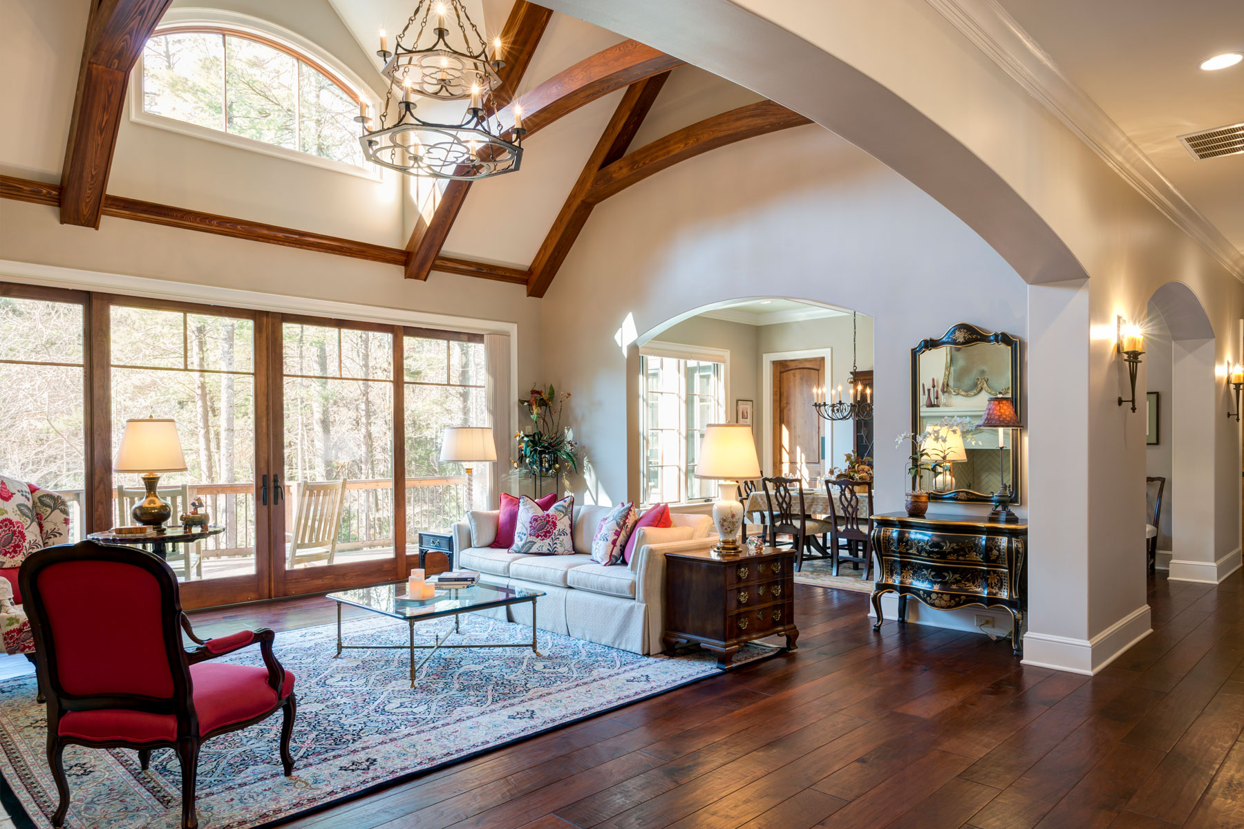 Formal living room with vaulted ceiling with timber beams