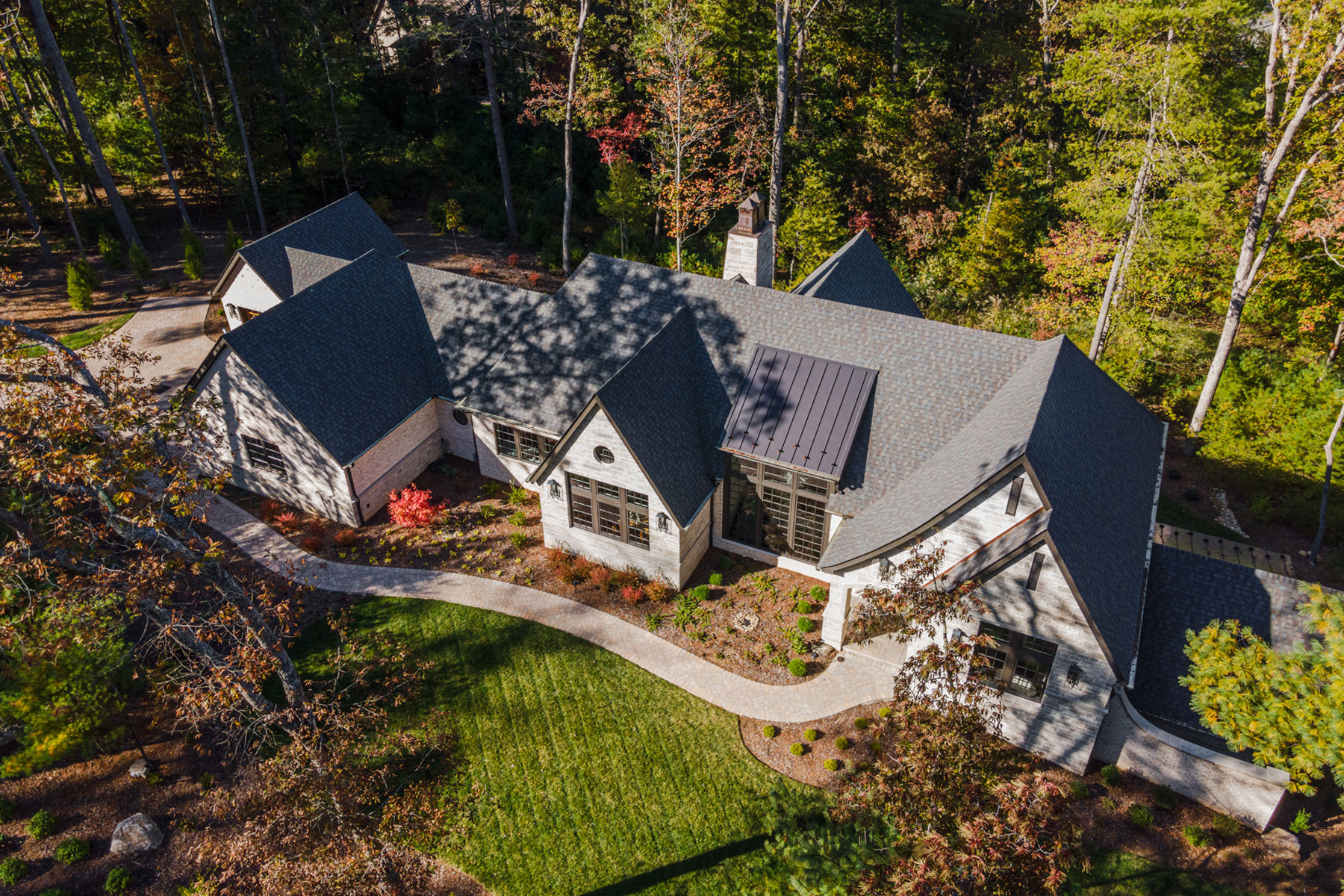 Aerial view of French Contemporary, Modern Ranch Home