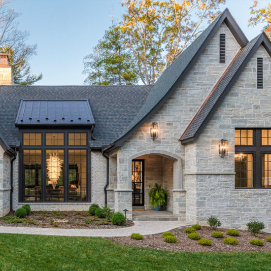Front elevation of new stone house designed by ACM Design of Asheville, NC