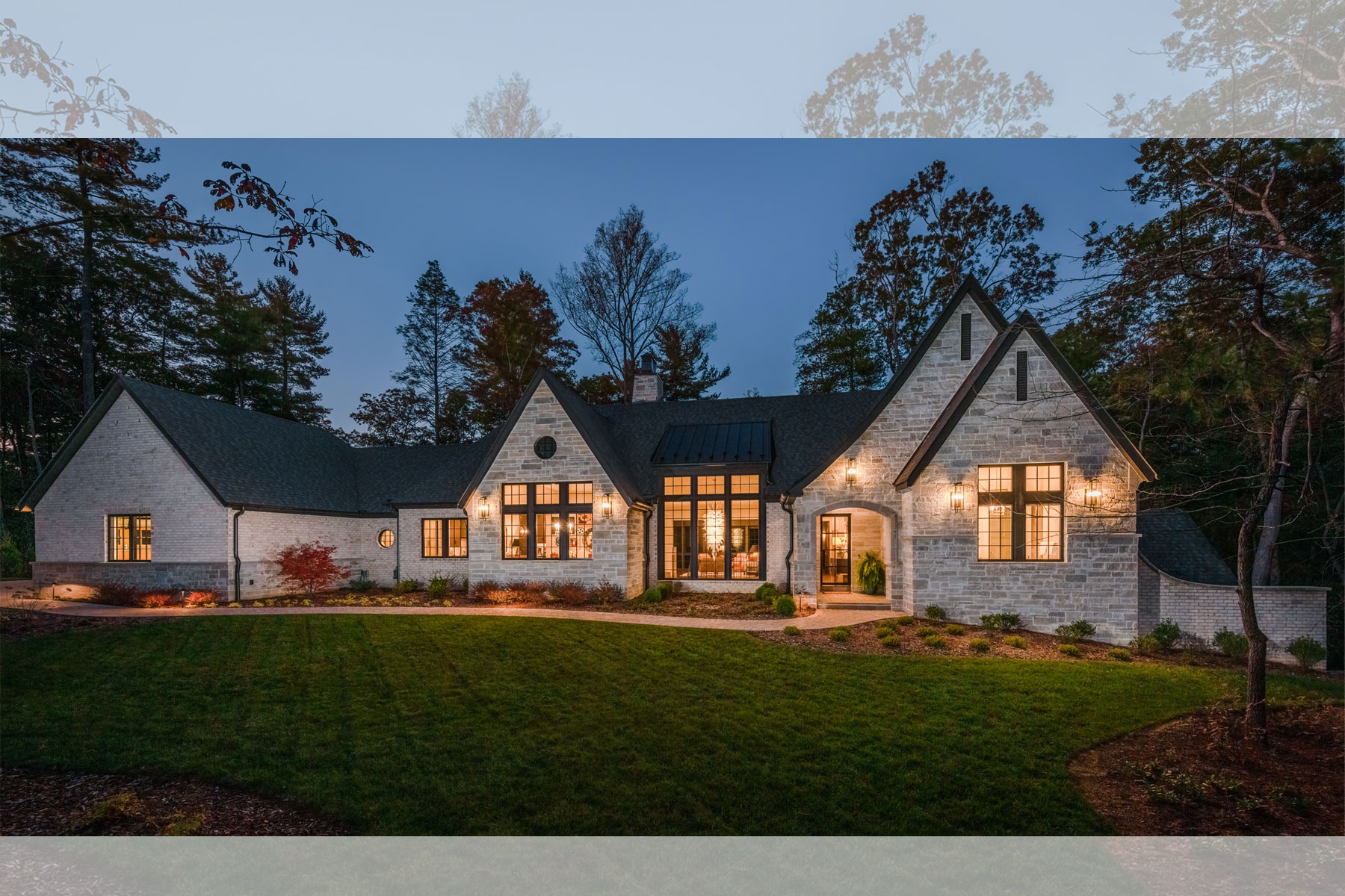 Nightime view of new Asheville home with European-influenced Architecture by Architects at ACM Design