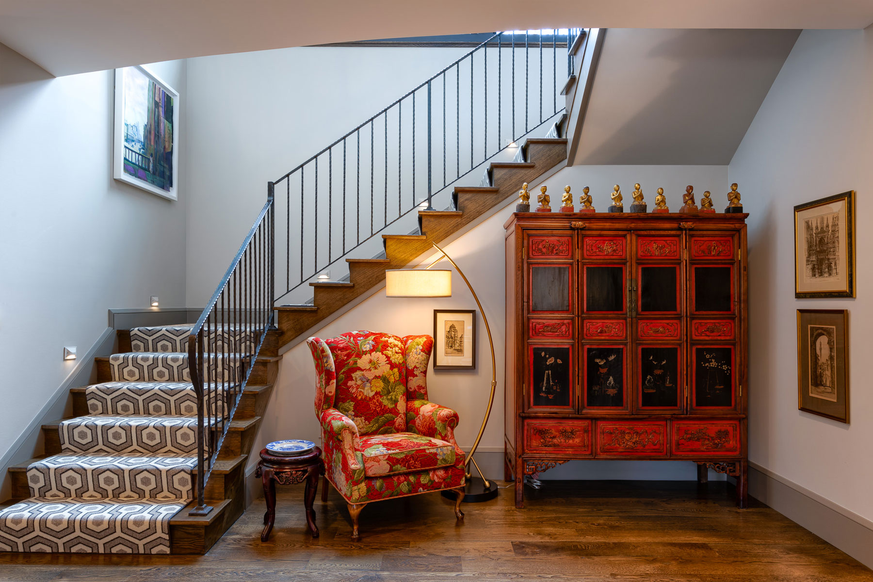 Custom furniture at the bottom landing of the staircase