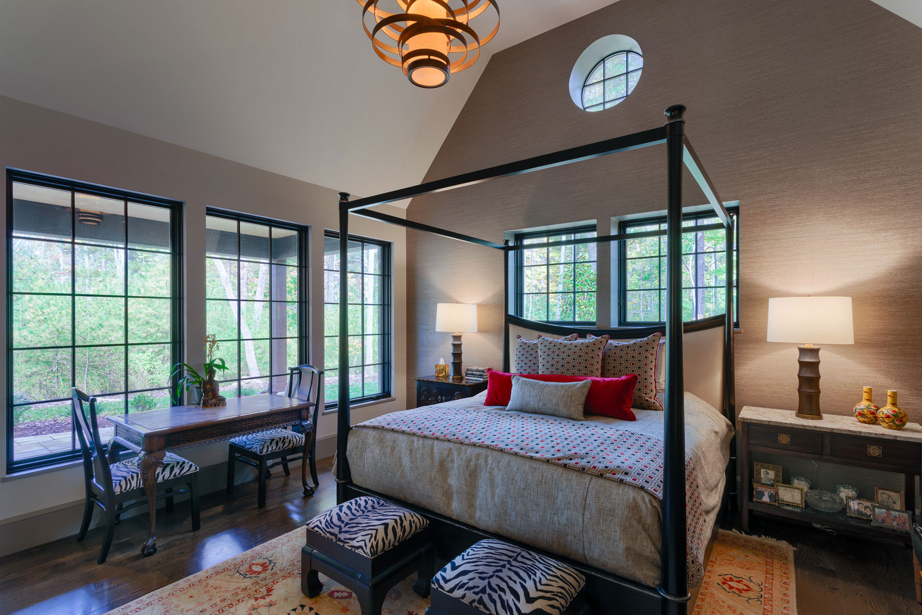 Second master suite with pitched ceiling on lower level of moutain home