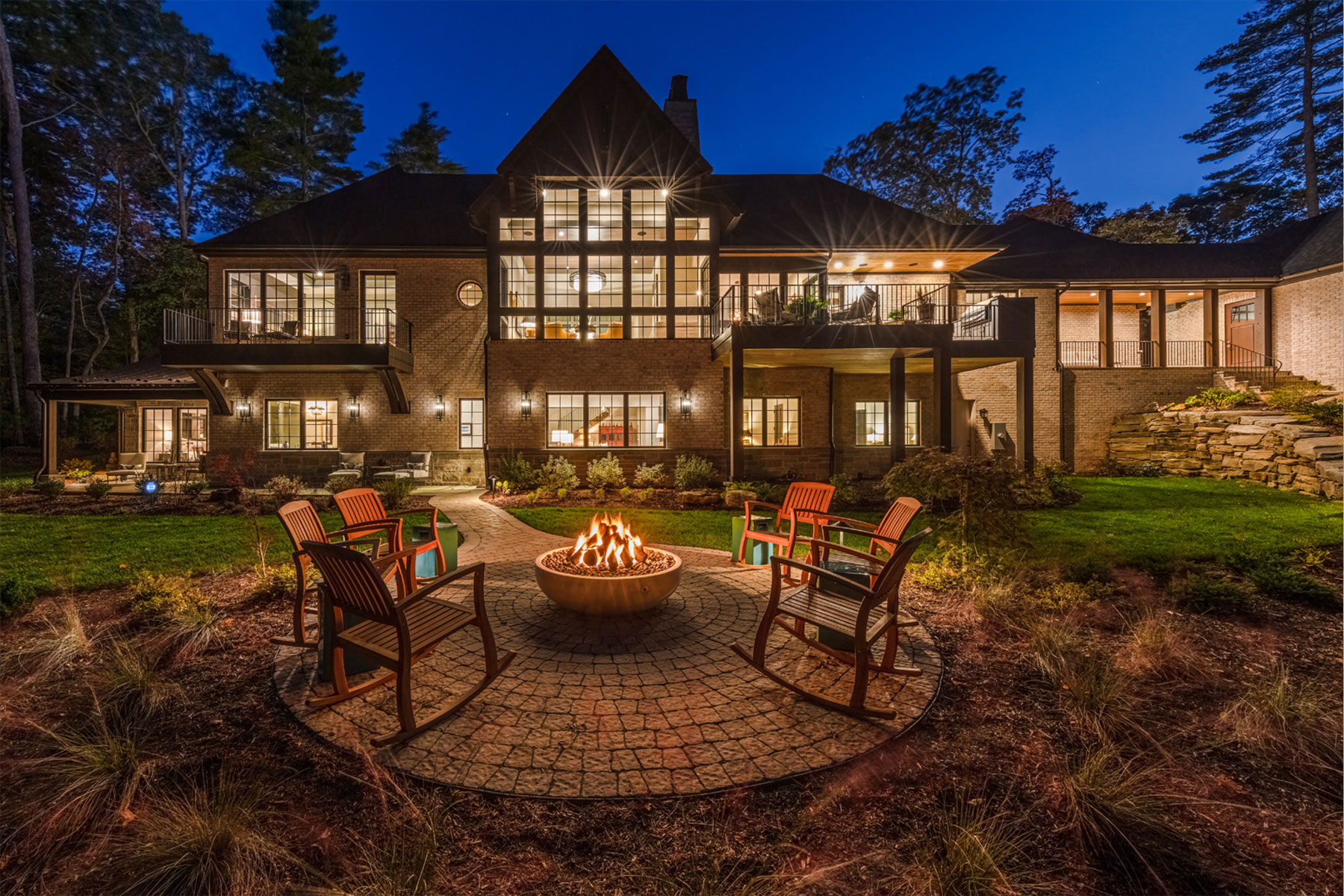 Custom designed mountain home with outdoor living area including firepit