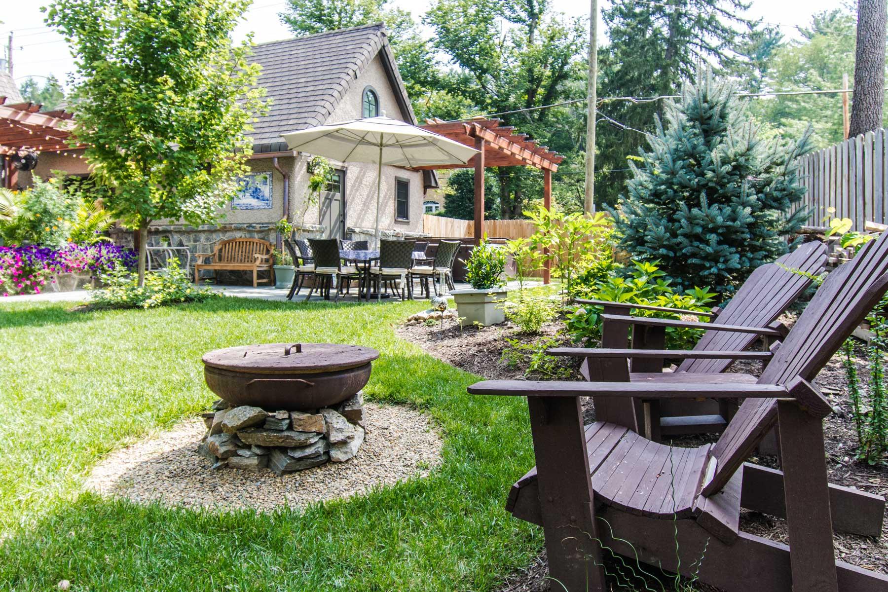 Backyard firepit in Grove Park Renovation