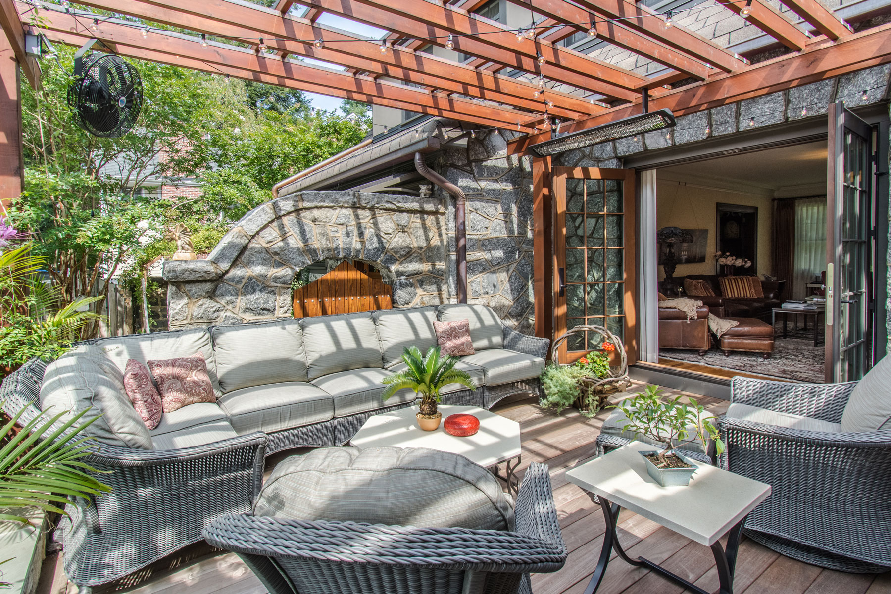 Patio with vintage stone work walls and new trellis to create outdoor living area