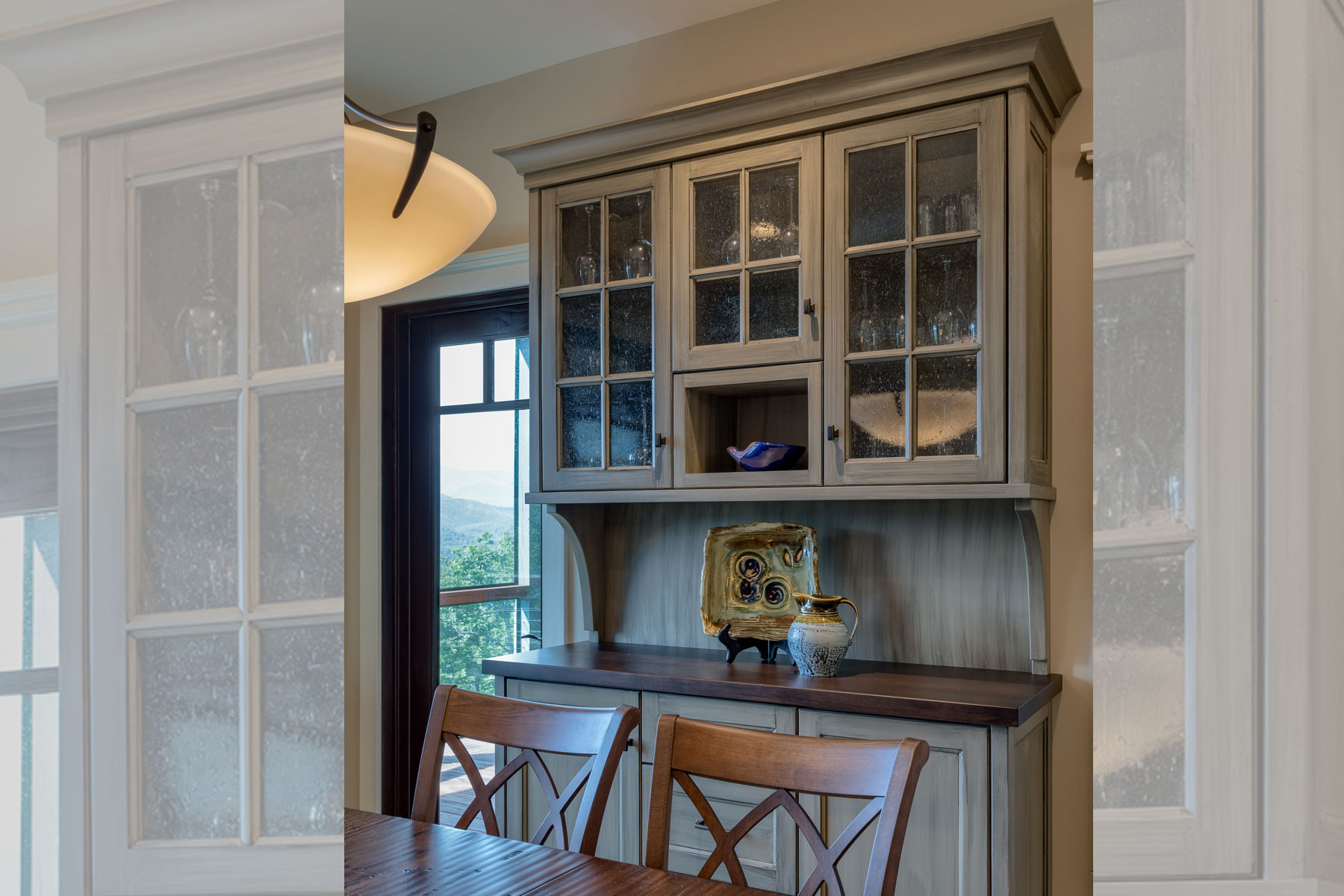 Custom, built in cabinetry to look like hutch
