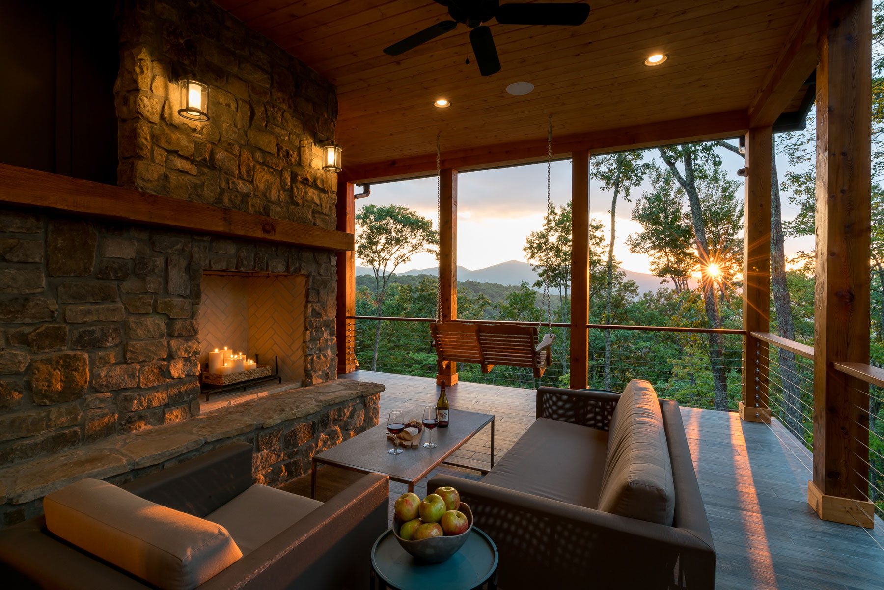 Deck with swing and fireplace with seating area above 4000 feet sea level