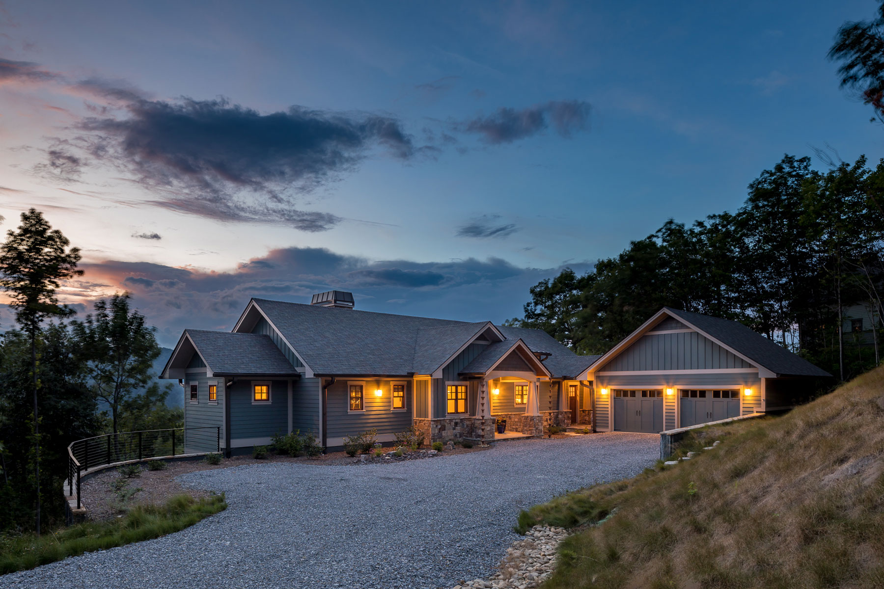 Sunset view of custom mountain craftsman with traditional and modern details