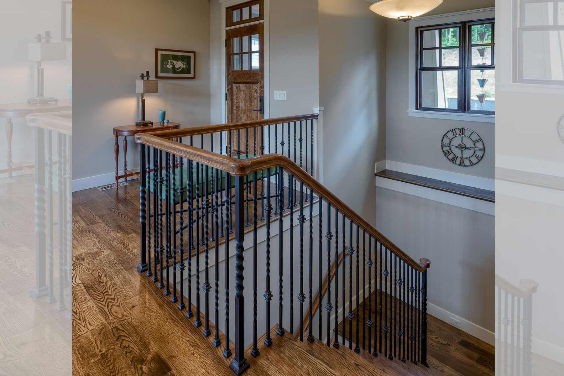 Custom stair rail design for steps leading down to lower level in mountain home