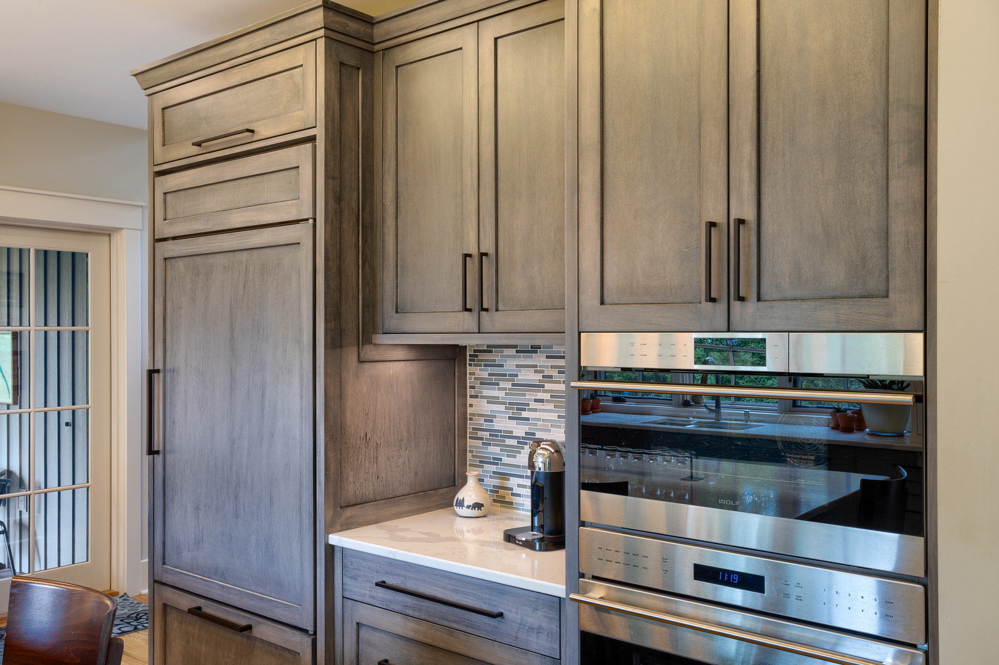 Appliance wall in new modern, rustic kitch with gray cabinets