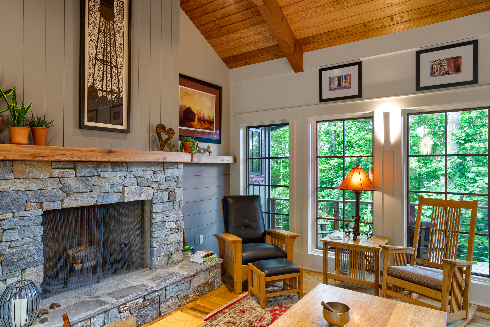 Craftsman style living room with rock fireplace