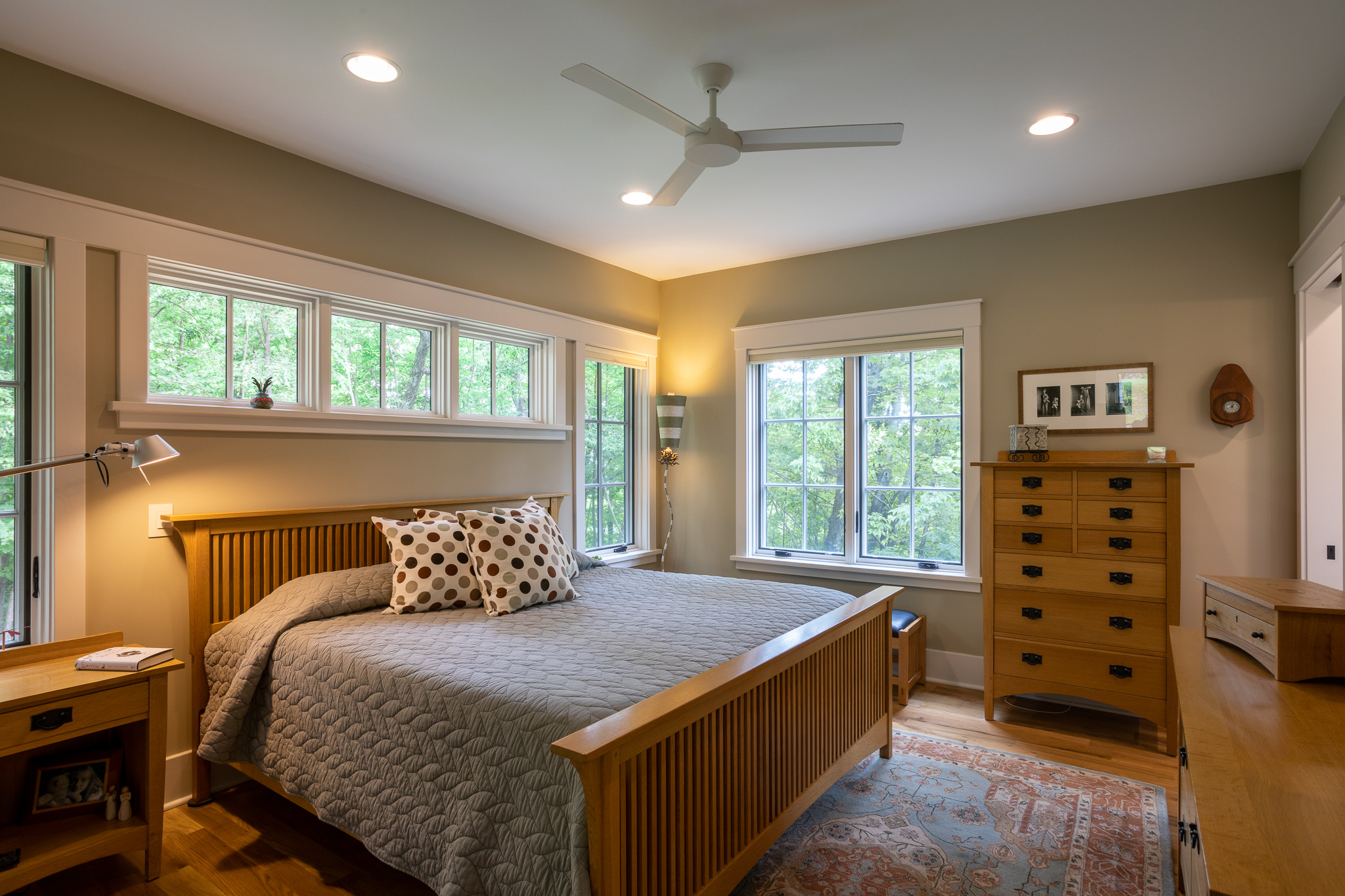 Master bedroom with transom windows over the bed